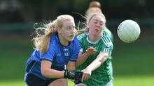 Seona Halligan, Roche Emmets is challenged by Rebecca Carr, Geraldines in the Ladies Senior Championship semi-final held in Dundalk Gaels. Pictures: Ken Finegan