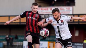 Dundalk's Andy Boyle challenges Ross Tierney of Bohemians. Photo: Sportsfile