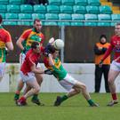 Carlow's Sean Gannon and Louth's Declan Byrne