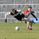 Kevin McDonnell takes flight after a challenge from Adrian Reid
