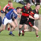 Peter Kirwan of Dreadnots gets away from Noamh Mairtin's Eamon McQuillan during Sunday's championship match in Dunleer