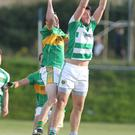 Alan Doyle of O'Raghallaigh's does well to collect a hight ball under pressure from Liam Dullaghan of Sean O'Mahonys