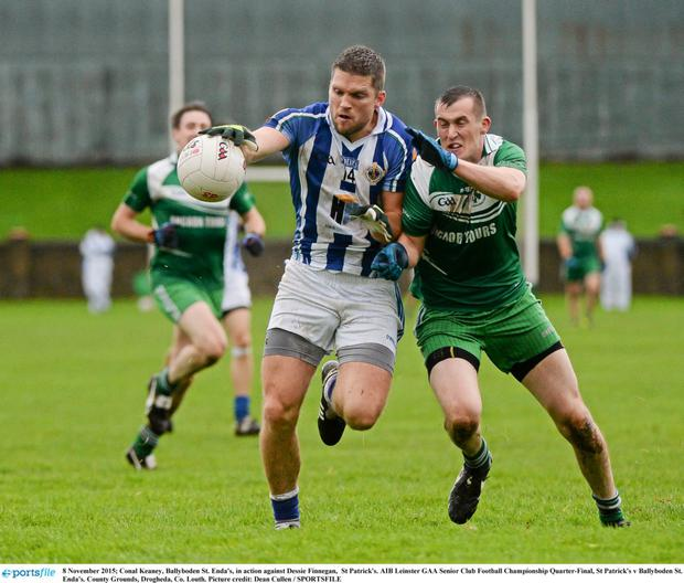 Conal Keaney of Ballyboden St. Enda's, in action against Dessie Finnegan of St Patrick's