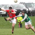 Patrick Reilly clears the ball for Louth as Adrian Moyles arrived with an attempted block for London