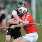 Shane Callan, Louth, comes under pressure from Aidan Morrisson, Sligo. Photo: Ken Finegan