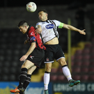 Andy Boyle of Dundalk in action against David O'Sullivan of Longford Town