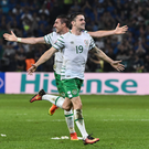 Goal hero Robbie Brady and Stephen Ward celebrate following the Republic of Ireland's victory over Italy at Euro 2016 in Lille. Photo: David Maher/Sportsfile
