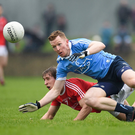 Louth's Anthony Williams clashes with Dublin's Ciaran Reddin during Sunday's O'Byrne Cup final.