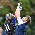 The crossbar comes to the Gaels rescue as Naomh Mairtin's JP Rooney puts pressure on 'keeper Stephen Faulkner. Pic: Ken Finegan