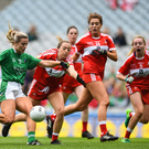 The Louth defence can only watch as Rebecca Delee of Limerick shoots to score her side's second goal during the TG4 All-Ireland Junior Championship Final at Croke Park. Pictures: Sportsfile.