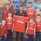 St Nicholas chairman Des McDonald (left) and captain Brian Carter (right), with (left to right) Evan Thornton, Rían Beck, Lucy Gregory and Patrick Gates, receive new jerseys from Jamie Kirwan of sponsor Hannons Centra, Ballsgrove