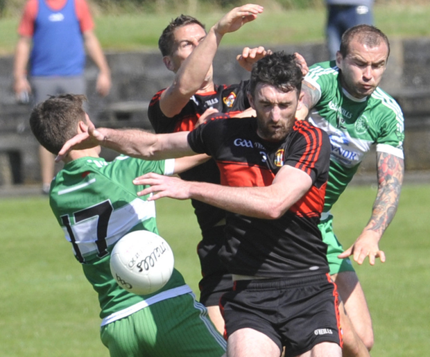 James Califf and Padraig Rath of Dreadnots clash in midfield with Jack Murphy and Paddy Keenan of St Patrick's
