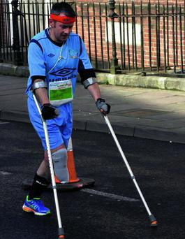 n Garry Hoey making history by competing in Great Limerick Run Marathon Relay on crutches alongside members of the Irish Amputee football squad.