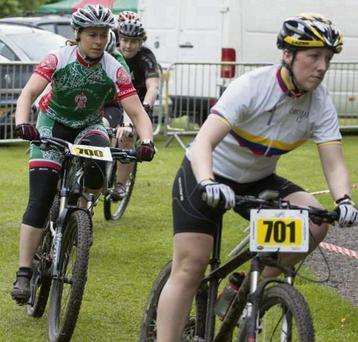 Sandra O'Hagan (green, red and white) from Cuchulainn CC in action in Belfast in Round 4 of the Irish XC NPS Series.