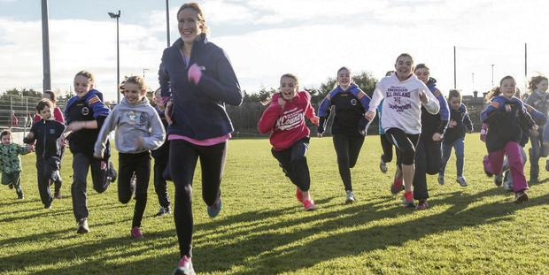 Catherina McKiernan puts a group of Blaclrock AC athletes through their paces at Sandy Lane. Picture: Niall Carroll