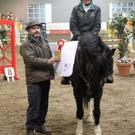 "Sinead Young and Jacobi, seen here being presented with their prizes came out on top of a huge entry in the 80cm class at the ""Bumper Christmas Show"" held at Ravensdale Lodge"