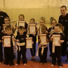 Members of MAC show off their grading certificates