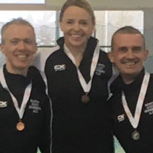 Maurice McMahon, Laura Matthews and Declan show off their medals.