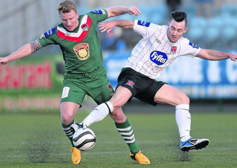 Richie Towell sticks a boot in to dispossess Cork City's Daryl Kavanagh