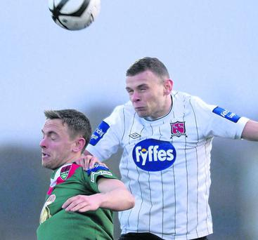 Andy Boyle wins a header decisively against Cork City striker Danny Furlong on Friday night.