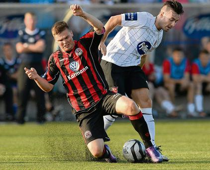 Bohemians' Conor Murphy is challenged by Richie Towell. Picture: David Maher/SPORTSFILE