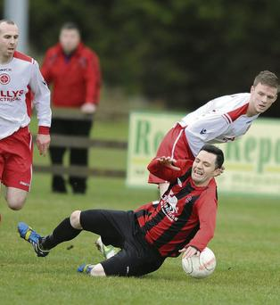 Ciaran Sheelan, Bellurgan, hits the deck after this challenge from Rock's David McGeough. Picture: Ken Finegan.