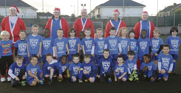 Glenmuir Academy Under-6s - coaches Barry Clarke (back, left), Ciaran Caldwell, Sean Hoey, Eamonn Farrell and Gary Rogers with the Under-6 group at Glenmuir Academy.