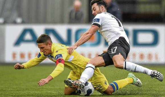 Richie Towell keeps the pressure on Limerick's Shane Duggan at Oriel Park