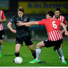 David McMillan dribbles past Derry's Shane McEleney at The Brandywell