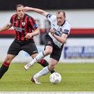 Dundalk's Chris Shields does well to keep his balance as he peels away from Stephen Rice of Longford Town during Saturday's clash at City Calling Stadium