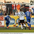 Dundalk goalkeeper Gary Rogers saves a penalty kick from Shane Tracy, Limerick FC