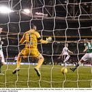 Cork City keeper Mark McNulty and defender Dan Murray are helpless as Richie Towell fires past them for the FAI Cup-winning goal