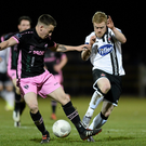 Aidan Friel gets a challenge in to stop the run of Dundalk's Daryl Horgan at Ferrycarrig Park on Monday night