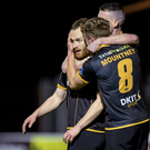 Stephen O'Donnell, Dundalk, left, celebrates with team-mates Ciaran Kilduff and John Mountney, after scoring his team's opening goal