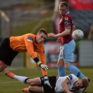 Dundalk's John Mountney feels the pain after this clash with Galway United goalkeeper Conor Winn