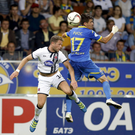 Dane Massey clashes in the air with Aleksei Rios of BATE during the match