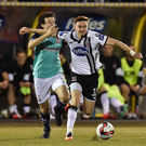 Ronan Finn tries to shrug off Barry McNamee of Derry City