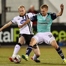 Lukas Schubert of Derry City in action against Chris Shields of Dundalk