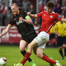 Chris Shields of Dundalk is challenged by Rory Feely of St Patrick's Athletic. Pictures: David Maher/Sportsfile