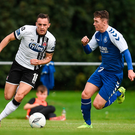 Dundalk's Dylan Connolly goes past Crumlin's Gerard Rowe during Saturday's FAI Cup clash at the Iveagh Grounds, while right, Conor Clifford attempts a long-range shot. Cody Glenn/Sportsfile