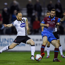 Stephen O'Donnell and Colm Deasy clash in midfield during Friday's clash at Oriel Park