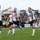 Robbie Benson celebrates scoring his side's goal with teammates Stephen O'Donnell, centre, and David McMillan, during the Irish Daily Mail FAI Cup semi final at Oriel Park. Photos: Stephen McCarthy/Sportsfile