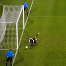 Mark McNulty of Cork City saves a penalty from Michael Duffy of Dundalk during the penalty shoot out during the shootout at the Aviva stadium