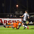 Robbie Benson shoots to score his side's first goal past Kevin Horgan of Shamrock Rovers during Friday's Premier Division match at Oriel Park. Photo: Seb Daly/Sportsfile