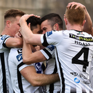 Patrick Hoban celebrates with teammates after scoring his side's first goal during the Premier Division match against Bohemians at Dalymount Park. Photo by Sam Barnes/Sportsfile