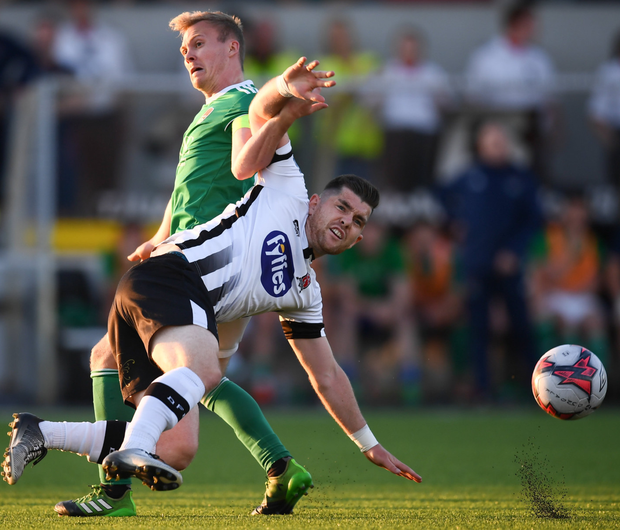 Ronan Murray of Dundalk in action against Conor McCormack of Cork City