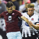 Gordan Walker of Cobh Ramblers is put under pressure by Sam Byrne of Dundalk during the Irish Daily Mail FAI Cup tie at Oriel Park