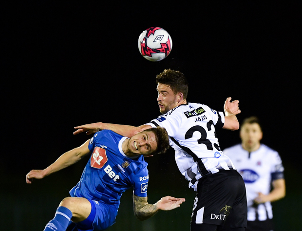 Dean Jarvis of Dundalk in action against Gavan Holohan of Waterford