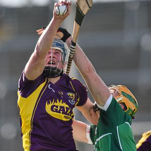 8 March 2015; Ian Byrne, Wexford, in action against Paul Browne, Limerick. Allianz Hurling League, Division 1A, Round 3, Wexford v Limerick, Wexford Park, Wexford. Picture credit: David Maher / SPORTSFILE