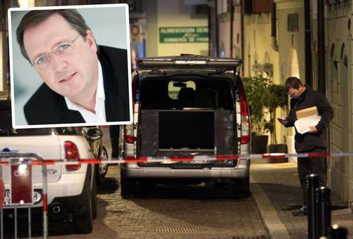 The scene outside the Swiss apartment where the wife of Enniscorthy man Harry Ringwood (inset) was found stabbed to death. Mr Ringwood has admitted to Swiss police to killing her.